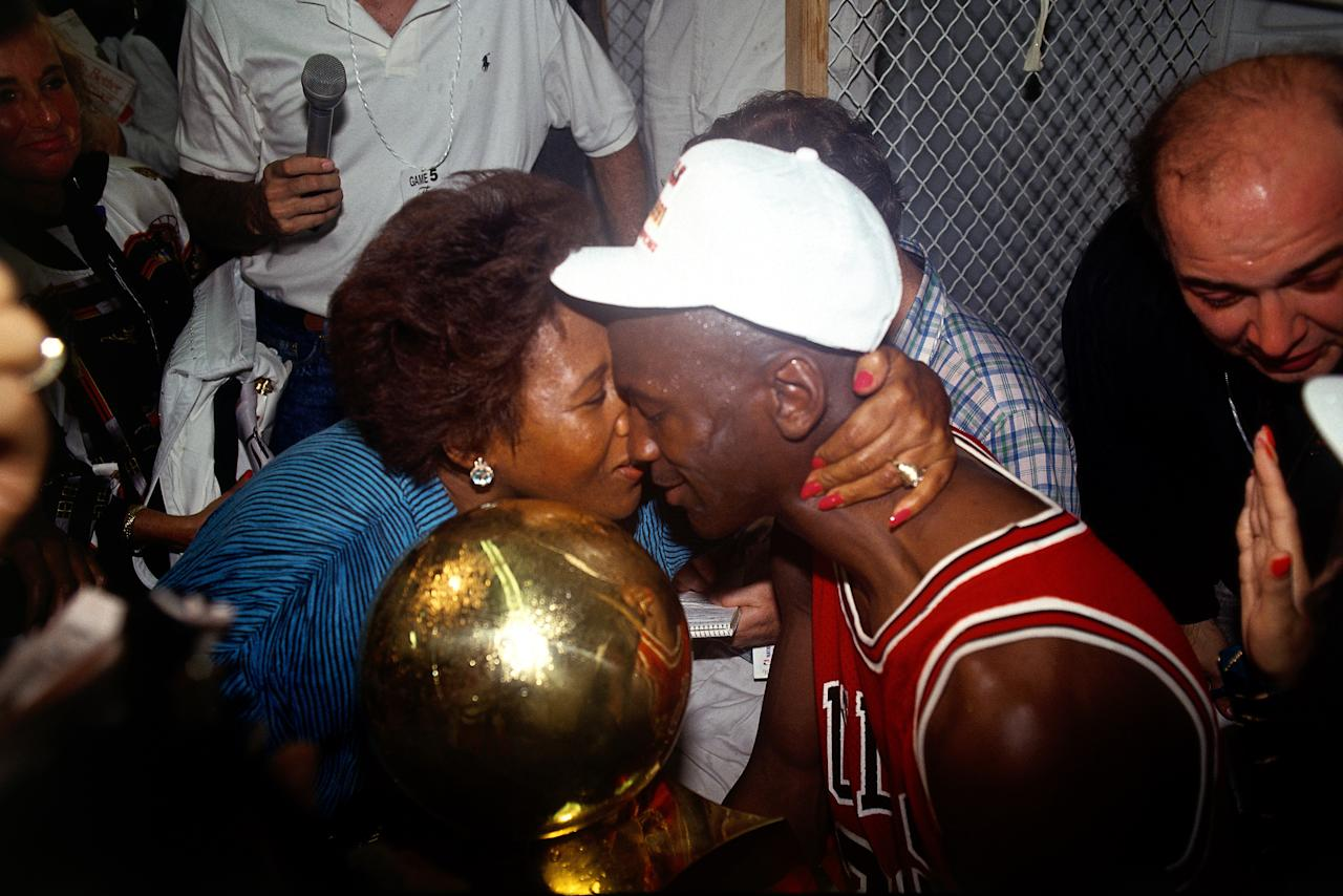 Michael Jordan #23 of the Chicago Bulls gets congratulated by his mom after winning the 1991 NBA Championship against the Los Angeles Lakers in Los Angeles, CA. HIGH RESOLUTION FILE 42MB. NOTE TO USER: User expressly acknowledges and agreesthat, by downloading and/or using this Photograph, User is consenting to the terms and conditions of the Getty Images License Agreement. Mandatory copyright notice and Credit: Copyright 2001 NBAE Mandatory Credit: Nathaniel S. Butler/NBAE/Getty Images