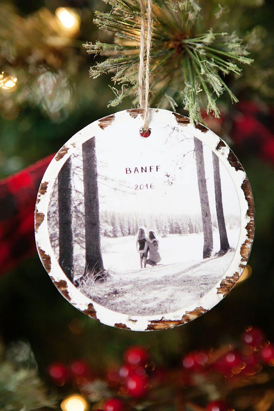 """<p>Make your favorite holiday memories last a lifetime with these quick personalized ornaments. Grab your photos, cut them into circles, and apply to wood slices using Mod Podge.</p><p><strong>Get the tutorial at <a href=""""http://simpleasthatblog.com/2016/12/10-minute-photo-keepsake-ornaments.html"""" rel=""""nofollow noopener"""" target=""""_blank"""" data-ylk=""""slk:Simple As That"""" class=""""link rapid-noclick-resp"""">Simple As That</a>.</strong><br></p><p><a class=""""link rapid-noclick-resp"""" href=""""https://www.amazon.com/Assorted-Decorations-Ornaments-Super-Outlet/dp/B01FRDI8EY/?tag=syn-yahoo-20&ascsubtag=%5Bartid%7C10050.g.1070%5Bsrc%7Cyahoo-us"""" rel=""""nofollow noopener"""" target=""""_blank"""" data-ylk=""""slk:SHOP WOOD SLICES"""">SHOP WOOD SLICES</a></p>"""