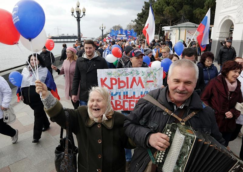 People take part in a rally in the Crimean city of Yalta, on March 18, 2016 to mark two years since Russia annexed Crimea (AFP Photo/Max Vetrov)