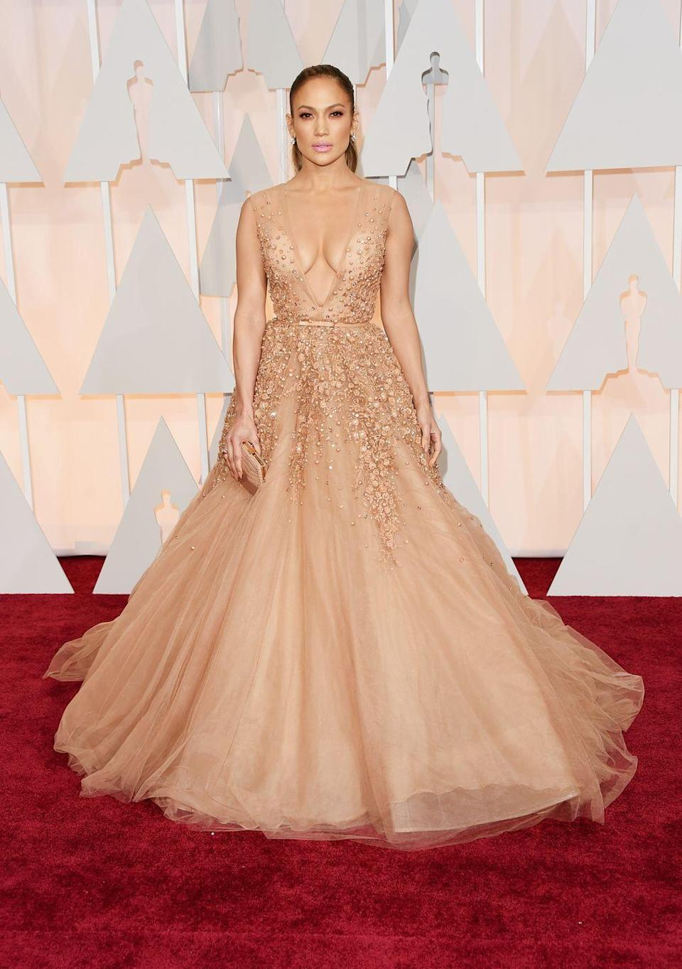 <p>In a sheer low-cut and princess skirt Elie Saab dress.</p>