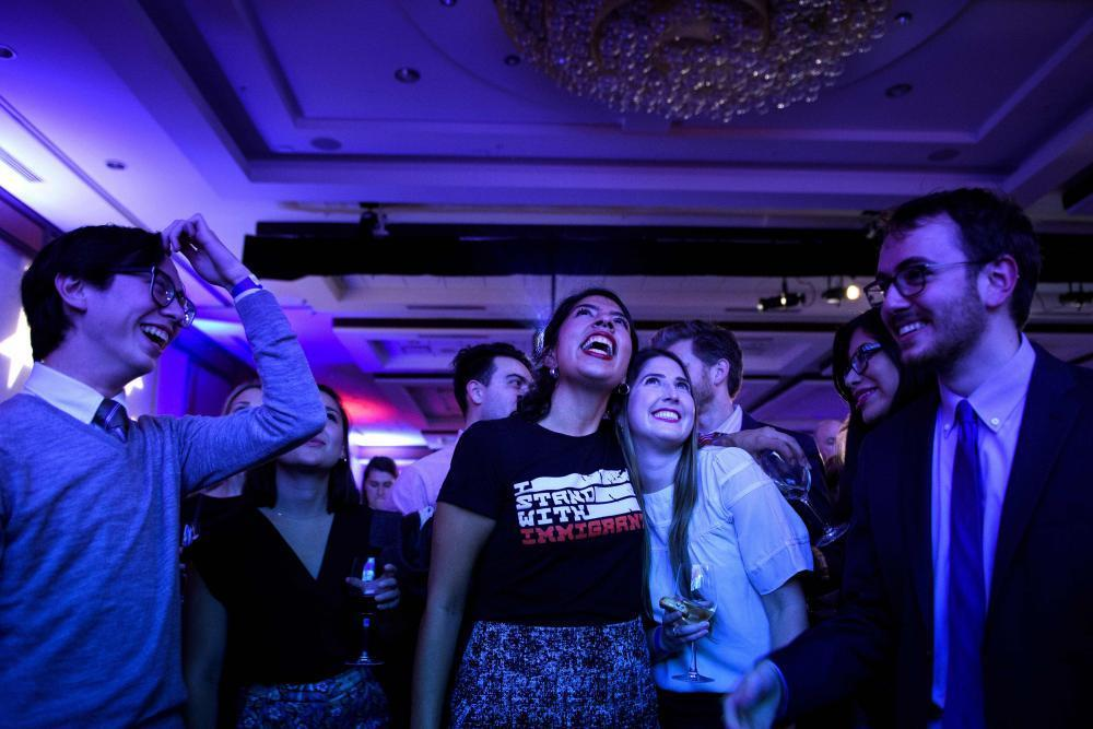 """<span class=""""element-image__caption"""">An election night party hosted by the Democratic Congressional Campaign Committee.</span> <span class=""""element-image__credit"""">Photograph: Brendan Smialowski/AFP/Getty Images</span>"""