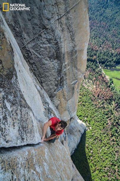 PHOTO: With California's Yosemite Valley far beneath him, Alex Honnold free solos—which means climbing without ropes or safety gear—up a crack on the 3,000-foot southwest face of El Capitan. ((Jimmy Chin/National Geographic)