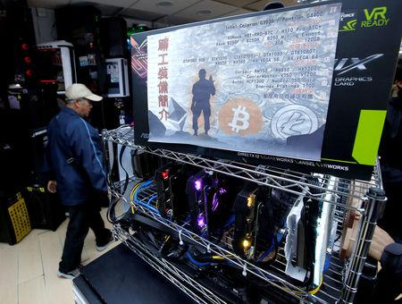 A cryptocurrency mining computer equipped with high-end graphic cards is seen on display at a computer mall in Hong Kong, China January 29, 2018. Picture taken January 29, 2018.  REUTERS/Bobby Yip