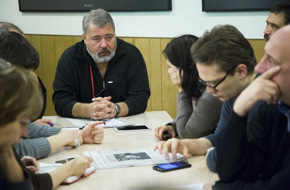 FILE - In this Friday, Oct. 9, 2015, file photo, Dmitry Muratov, the editor of Novaya Gazeta, center left, attends a planning meeting with the editorial board, in Moscow, Russia. As a new Nobel Peace Prize laureate, Russian newspaper editor Dmitry Muratov has downplayed the buzz around his name. The award isn't for him, he says, but for all of the staff at Novaya Gazeta, the independent Russian newspaper noted for investigations of official corruption, human rights abuses and Kremlin criticism. (AP Photo/Alexander Zemlianichenko, File)