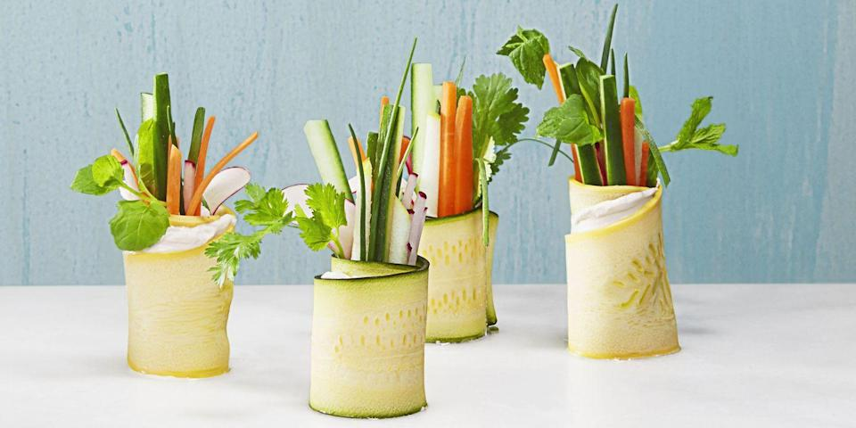 """<p>Straight of the garden, these vegan snacks also happen to be keto-friendly, too. Plate them right before your guests arrive, as they can stand at room temp for up to an hour. </p><p><em><em><a href=""""https://www.goodhousekeeping.com/food-recipes/party-ideas/how-to/a33054/how-to-make-veggie-rolls/"""" rel=""""nofollow noopener"""" target=""""_blank"""" data-ylk=""""slk:Get the recipe for Keto Veggie Rolls »"""" class=""""link rapid-noclick-resp"""">Get the recipe for Keto Veggie Rolls <em><em>»</em></em></a></em></em> </p>"""