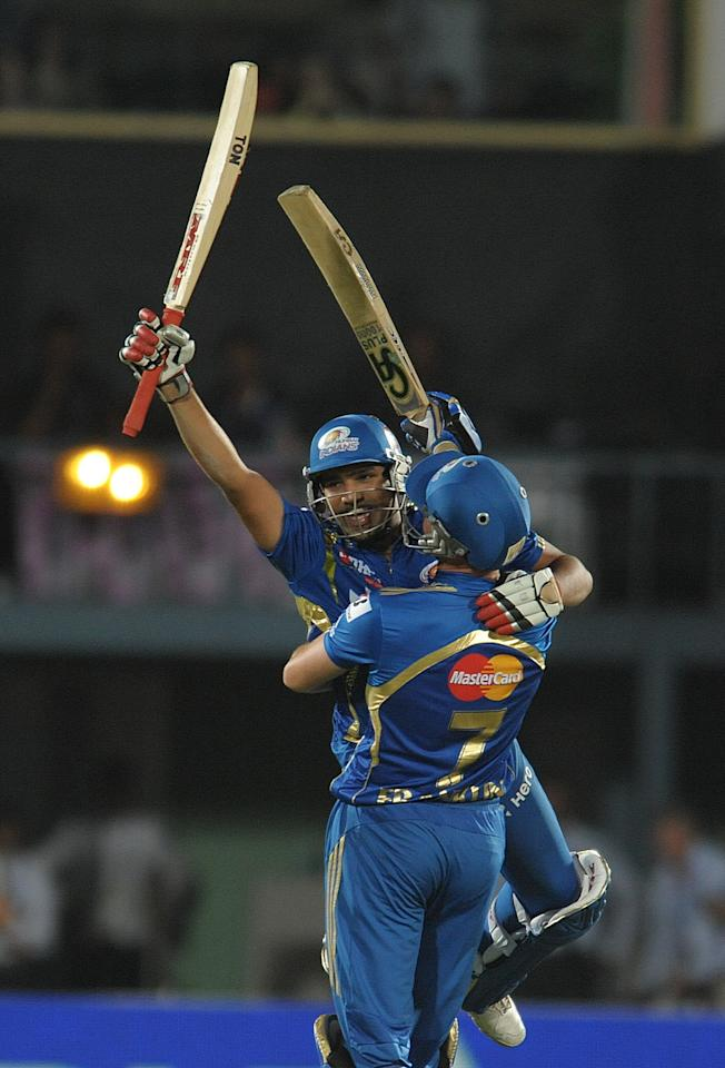 Mumbai Indians batsman Rohit Sharma celebrates with a teammate after winning shot on April 9, 2012 during the IPL Twenty20 cricket match against the Deccan Chargers at the Dr. Y.S. Rajasekhara Reddy Cricket Stadium in Visakhapatnam.                            AFP PHOTO / NOAH SEELAM RESTRICTED TO EDITORIAL USE. MOBILE USE WITHIN NEWS PACKAGE (Photo credit should read NOAH SEELAM/AFP/Getty Images)