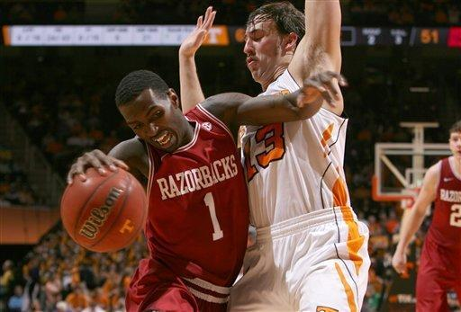 Arkansas guard Mardracus Wade (1) tries to get around Tennessee guard Skylar McBee (13) during the second half of an NCAA college basketball game at Thompson-Boling Arena in Knoxville, Tenn., Wednesday, Feb. 15, 2012. Tennessee won 77-58 over Arkansas. (AP Photo/Knoxville News Sentinel, Adam Brimer)