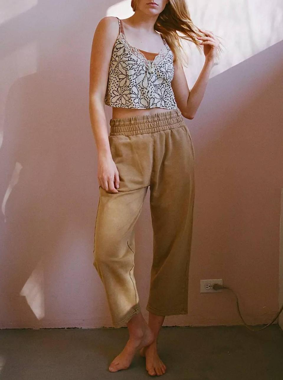 """$49, Urban Outfitters. <a href=""""https://www.urbanoutfitters.com/shop/out-from-under-olive-slouchy-sweatpant?"""" rel=""""nofollow noopener"""" target=""""_blank"""" data-ylk=""""slk:Get it now!"""" class=""""link rapid-noclick-resp"""">Get it now!</a>"""