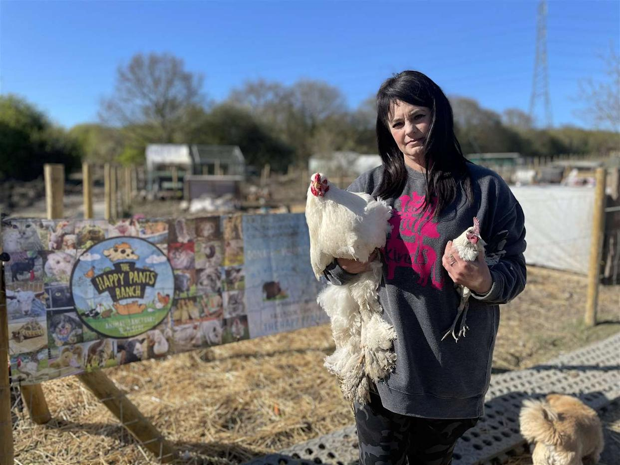 Founder Amey James, with cockerels, at The Happy Pants Ranch animal sanctuary at Bobbing. (SWNS)