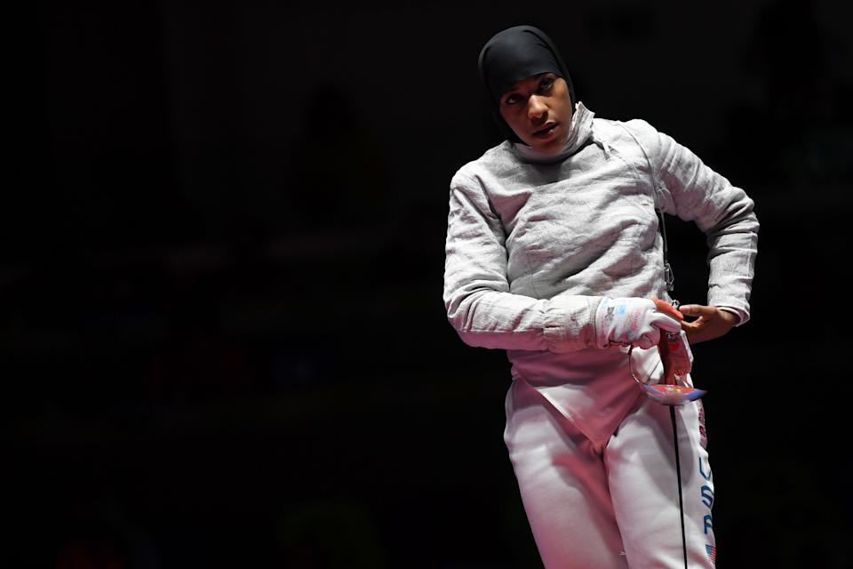 US Ibtihaj Muhammad reacts  during the womens team sabre bronze medal bout between US and Italy as part of the fencing event of the Rio 2016 Olympic Games, on August 13, 2016, at the Carioca Arena 3, in Rio de Janeiro. / AFP / Kirill KUDRYAVTSEV        (Photo credit should read KIRILL KUDRYAVTSEV/AFP via Getty Images)