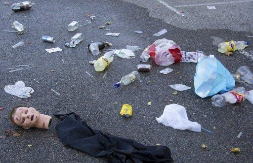 Part of a Halloween costume and rubbish at the car park of the Madrid Arena stadium on November 1