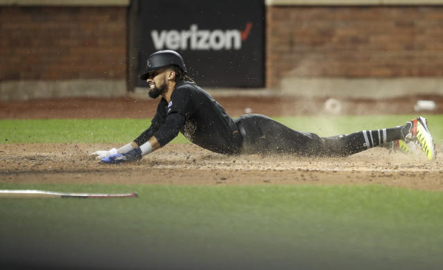 Atlanta Braves' Billy Hamilton scores during the eighth inning of the team's baseball game against the New York Mets, Saturday, Aug. 24, 2019, in New York. (AP Photo/Mary Altaffer)