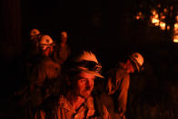 Firefighters take a break while setting a backfire in an attempt to prevent the Caldor Fire from spreading near South Lake Tahoe, Calif., Wednesday, Sept. 1, 2021. (AP Photo/Jae C. Hong)