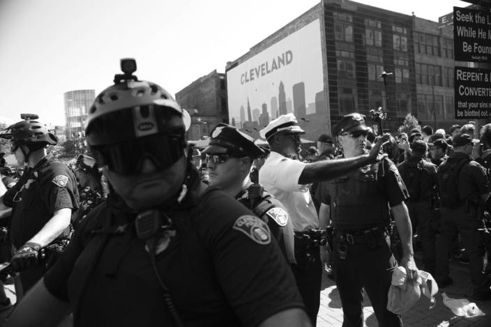 <p>Cleveland Police Chief Calvin D. Williams (center in white) on the scene of a clash with protesters outside of the convention. (Photo: Khue Bui for Yahoo News)</p>