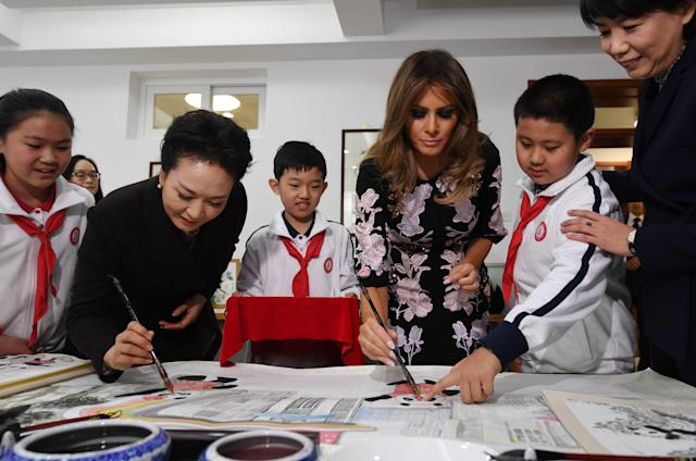 <p>First Lady Melania Trump and China's First Lady Peng Liyuan (2nd L) paint the eyes onto Panda figures in a calligraphy class during a visit to Banchang Primary School in Beijing on Nov. 9, 2017. (Photo: Greg Baker/AFP/Getty Images) </p>
