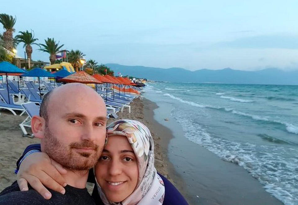 A photo of Semra Aysal with her husband on the beach.