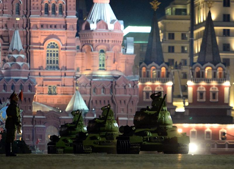 Soviet-era T 34 tanks ride through Red Square in Moscow during the Victory Day military parade night training on May 4, 2015 (AFP Photo/Vasily Maximov)