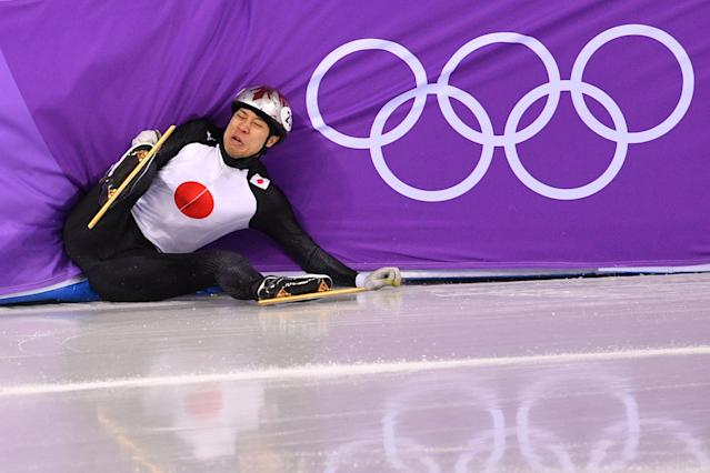 <p>Japan's Ryosuke Sakazume crashes in the men's 1,000m short track speed skating heat event during the Pyeongchang 2018 Winter Olympic Games, at the Gangneung Ice Arena in Gangneung on February 13, 2018. / AFP PHOTO / Mladen ANTONOV (Photo credit should read MLADEN ANTONOV/AFP/Getty Images) </p>
