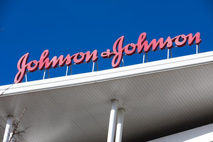 """MADRID, SPAIN – NOVEMBER 19: A sign for Johnson & Johnson is seen outside the Johnson & Johnson headquarters on November 19, 2020 in Madrid, Spain. The Spanish Agency for Medicines and Health Products (AEMPS) has authorized the first phase 3 clinical trial on November 18, 2020 for the COVID-19 vaccine from the company Janssen, belonging to the American multinational Johnson & Johnson. Trials of this vaccine had to be stopped due to """"unexplained illness"""" in one participant. The tests were resumed eleven days later, after verifying that the event was not related to the administration of the drug. (Photo by David Benito/Getty Images)"""
