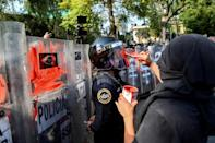 The crackdown sparked protests in Mexico City where demonstrators faced off against riot police