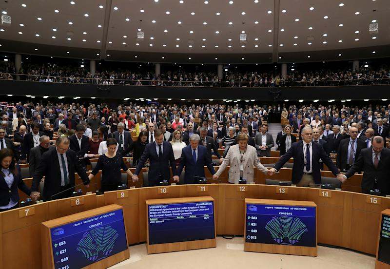 Members of the European Parliament react after voting on the Brexit deal during a plenary session at the European Parliament in Brussels, Belgium January 29, 2020. REUTERS/Yves Herman/Pool