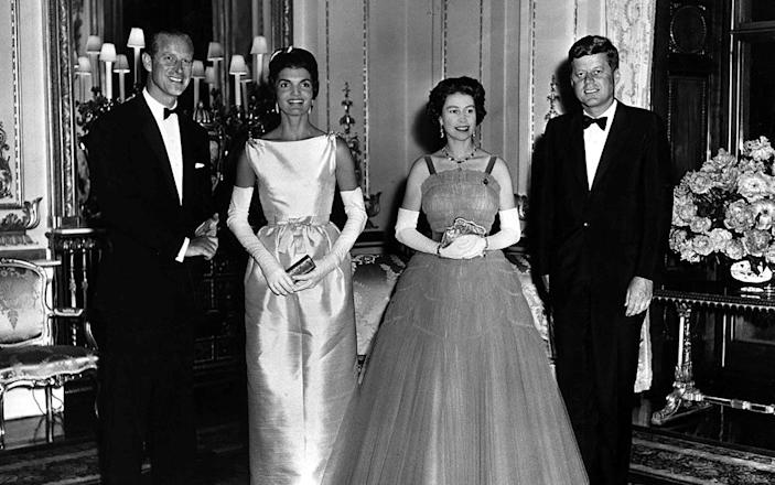 Queen Elizabeth II and Prince Philip pose with U.S. President John F. Kennedy and First Lady Jacqueline Kennedy at Buckingham Palace in London - REUTERS