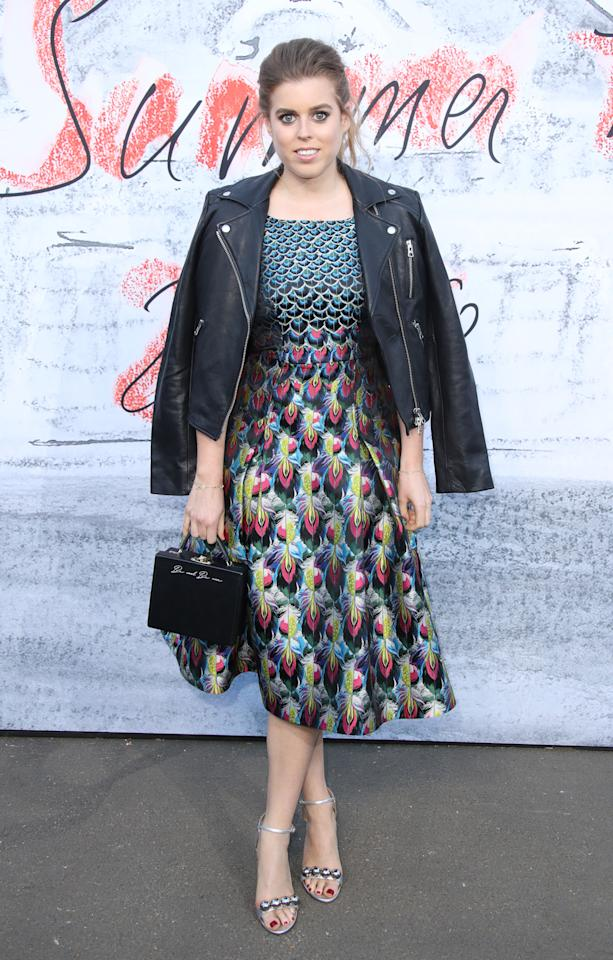 <p>Beatrice made a statement in a printed dress by London Fashion Week designer Mary Katranzou. She finished the look with an edgy leather jacket, worn draped over the shoulders. <em>[Photo: Getty]</em> </p>