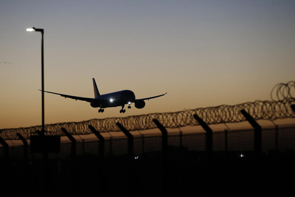 LONDON, ENGLAND - FEBRUARY 26: A plane arrives at Heathrow Airport on February 26, 2021 in London, England. Travellers arriving in the UK from February 15 2021 onwards from countries on the