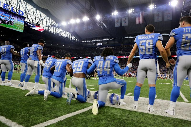 Members of the Detroit Lions take a knee during the playing of the national anthem on September 24, 2017 in Detroit, Michigan