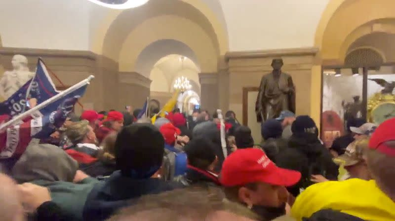 FILE PHOTO: Supporters of U.S. President Donald Trump storm the Capitol in Washington