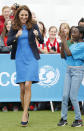 <p>Kate attended a SportsAid reception in a royal blue dress by Stella McCartney and a navy Smythe blazer. A suede L.K. Bennett clutch and cork wedges by Stuart Weitzman finished off the look.</p><p><i>[Photo: PA]</i></p>