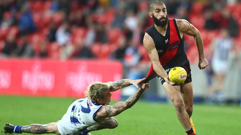 Essendon's Adam Saad is pictured breaking a tackle during the 2020 AFL season.