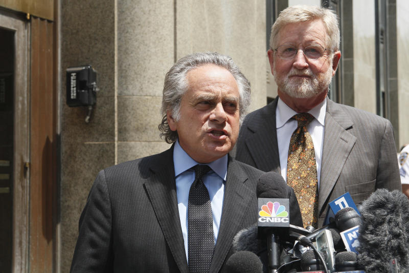 Dominique Strauss-Kahn's attorneys Benjamin Brafman, left, and William Taylor speak to reporters after meeting at the Manhattan District Attorneys office,  Wednesday, July 6, 2011 in New York.  A judge released Strauss-Kahn last week without bail or home confinement in the sexual assault case against him after prosecutors acknowledged serious questions about the credibility of the hotel maid who accused him of sexual assault. The criminal case against him stands.   (AP Photo/Mary Altaffer)