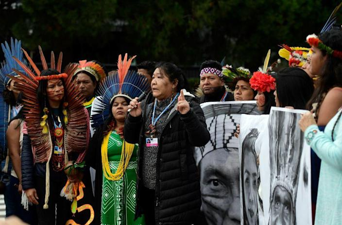 "Indigenous rights defender, Brazilian lawyer Joenia Batista de Carvalho aka Joenia Wapichana takes part in a demonstration demanding climate justice outside the venue of the UN Climate Change Conference COP25 at the in Madrid, on December 9, 2019.<span class=""copyright"">Cristina Quicler –AFP/Getty Images</span>"