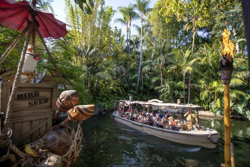 Anaheim, CA - July 09: Passengers ride the Jungle Cruise ride at Adventureland, Disneyland in Anaheim, CA, on Friday, July 9, 2021. The official reopening of Jungle Cruise will be on July 16, 2021, with new adventures, an expanded storyline and more humor as skippers take guests on a tongue-in-cheek journey along some of the most remote rivers around the world at Disneyland. What's new: The expanded backstory centers around Alberta Falls, the granddaughter of the world-renowned Dr. Albert Falls, who is now proprietor of the Jungle Navigation Company Ltd. New scenes include: A safari of explorers from around the world finds itself up a tree after the journey goes awry. Chimpanzees have taken over the expedition's wrecked boat. A Lost & Found location has turned into a Gift Shop run by Alberta's longtime friend, Trader Sam. (Allen J. Schaben / Los Angeles Times)