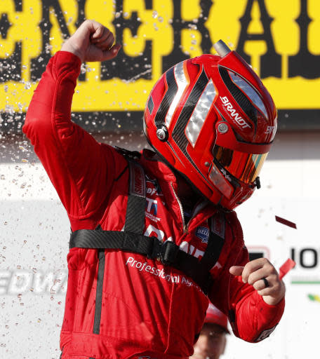 Justin Allgaier celebrates in Victory Lane after winning a NASCAR Xfinity Series auto race, Sunday, June 17, 2018, at Iowa Speedway in Newton, Iowa. (AP Photo/Charlie Neibergall)