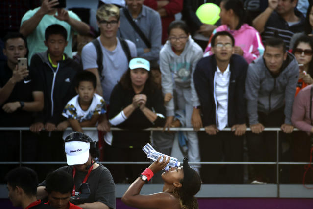 Naomi Osaka of Japan drinks from her bottle after defeating Danielle Collins of United States in a second-round match at the China Open Tennis tournament in Beijing, China, Tuesday, Oct. 2, 2018. Osaka beat Collins 6-1, 6-0. (AP Photo/Ng Han Guan)
