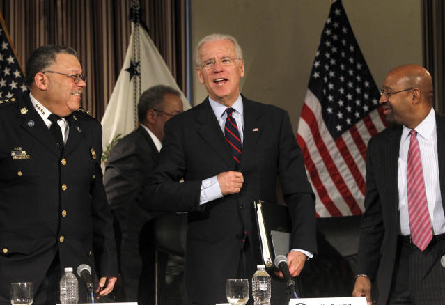 U.S. Vice President Joe Biden (C) makes a remark on the resignation of Pope Benedict XVI next to Philadelphia Mayor Michael Nutter (R) and Police Commissioner Charles Ramsay (L) at the conclusion of a roundtable discussion on gun control at Girard College in Philadelphia, Pennsylvania, February 11, 2013. Biden was joined by members of law enforcement and politicians to discuss gun law reforms. REUTERS/Tim Shaffer (UNITED STATES - Tags: POLITICS CRIME LAW) - RTR3DNI7