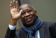 Former Ivory Coast president Laurent Gbagbo greets supporters attending the court session at the International Criminal Court in The Hague, Netherlands, Thursday, Feb. 6, 2020. Gbagbo is scheduled to return home to Ivory Coast Thursday June 17, 2021 for the first time in nearly a decade. The move comes after his acquittal on war crimes charges was upheld at the International Criminal Court earlier this year. (AP Photo/Jerry Lampen, Pool)
