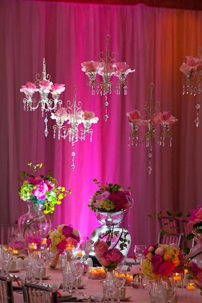 This publicity photo provided by Prince George Hotel shows tall vessels, with submerged flower blooms that set a dramatic table at this late spring wedding with a romantic evening theme. After a period of unpopularity, wedding reception flowers are back in a big way, says Craig Norton, Director of Operations for Halifax Canada's Prince George Hotel, which hosts 40 to 50 weddings each year. (AP Photo/Prince George Hotel, Liam Hennessey, Applehead Studio, Inc.)