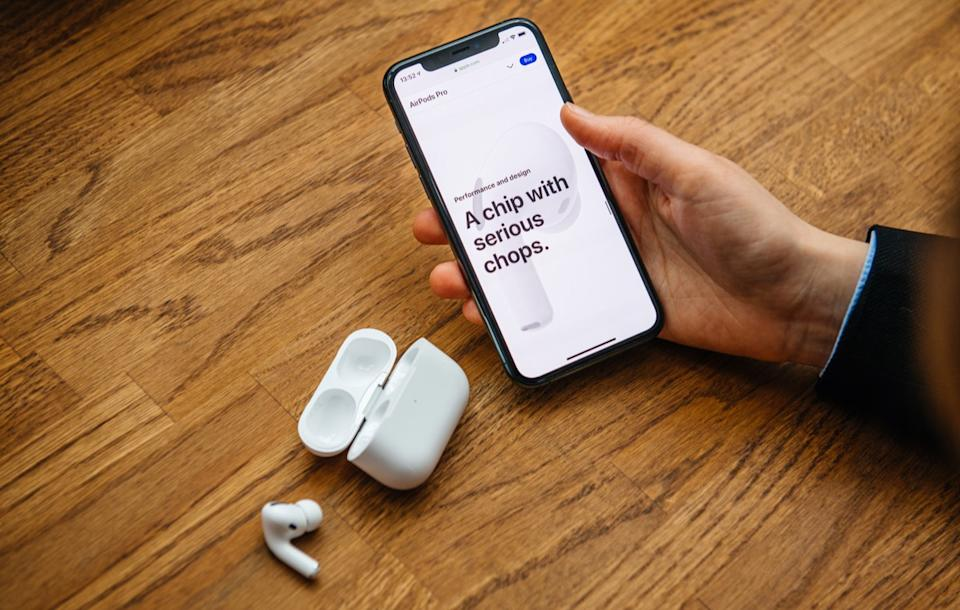 Paris, France - Oct 30, 2019: Overhead view of woman hands unboxing new Apple Computers AirPods Pro headphones with Active Noise Cancellation for immersive sound - a chip with serious chops