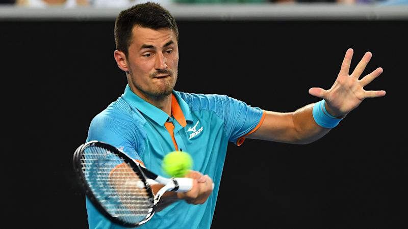 Tomic sets up Isner clash in New York