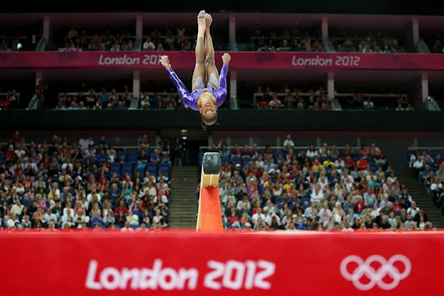 LONDON, ENGLAND - JULY 29: Gabrielle Douglas of the United States competes in the beam in the Artistic Gymnastics Women's Team qualification on Day 2 of the London 2012 Olympic Games at North Greenwich Arena on July 29, 2012 in London, England. (Photo by Ronald Martinez/Getty Images)
