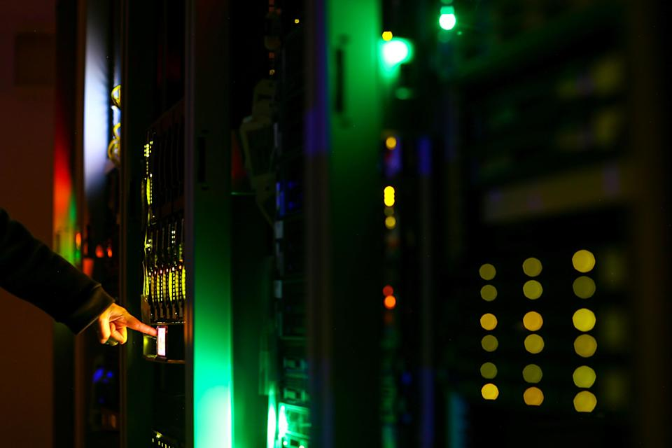 A man poses inside a server room at an IT company in this illustration photo. (Photo: Reuters/Athit Perawongmetha/Illustration)