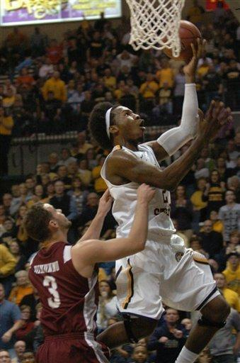 Murray State's Edward Daniel (2) is fouled by Eastern Kentucky's Mike Dinunno (3) in the second half of an NCAA college basketball game on Wednesday, Jan. 4, 2012, in Murray, Ky. (AP Photo/Stephen Lance Dennee)