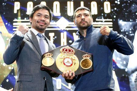 "Philippine boxing icon Manny ""Pacman"" Pacquiao and welterweight world title holder Lucas Matthysse pose for photographers during a news conference for their upcoming WBA ""regular"" welterweight title fight, at a hotel in Kuala Lumpur, Malaysia April 20, 2018. REUTERS/Lai Seng Sin"