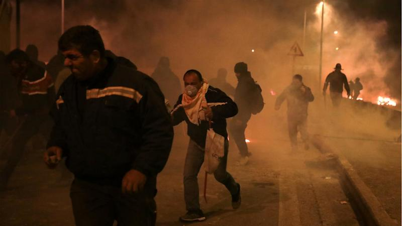 Greek islanders assail riot police in protests over migrant camps