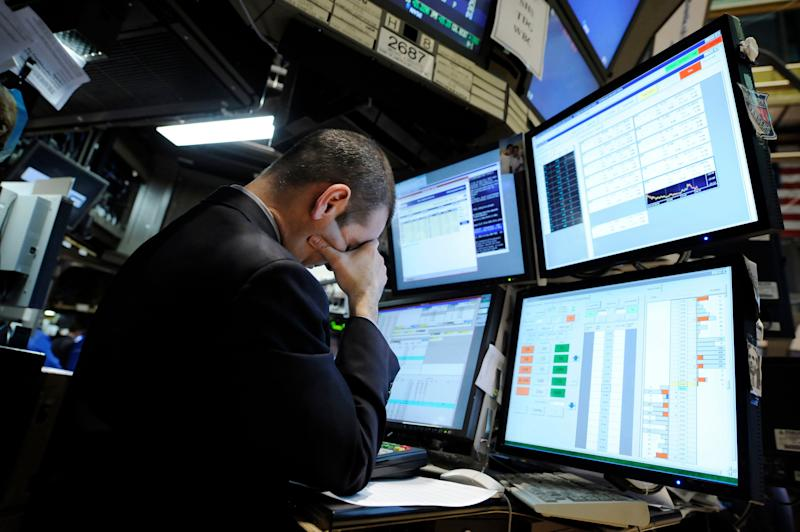 ** FILE ** In this March 2, 2009 file photo, specialist Michael Sollitto works on the floor of the New York Stock Exchange. The Dow Jones industrial average plummeted below 7,000 at the opening bell and kept driving lower that day, finishing at 6,673 _ a loss of nearly 300 points. The first quarter on Wall Street was so extreme it included a bear market and a bull market all its own _ moves that sometimes take years or more. Now investors head for spring still unsure which side is in control. (AP Photo/Richard Drew, file)