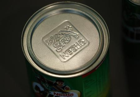 A Nestle logo is pictured on a Milo tin in a showroom at the company headquarters in Vevey