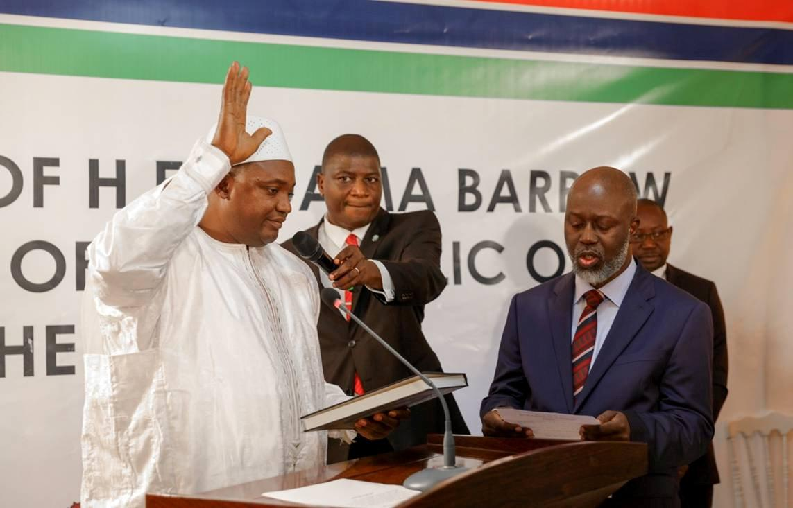 The swearing-in ceremony at the inauguration of Gambia President Adama Barrow at the Gambian embassy in Dakar, Senegal January 19, 2017, is seen in this handout photo provided by Office of the Senegal Presidency. Picture taken January 19, 2017. REUTERS/Office of the Senegal Presidency/Handout  THIS IMAGE HAS BEEN SUPPLIED BY A THIRD PARTY. IT IS DISTRIBUTED, EXACTLY AS RECEIVED BY REUTERS, AS A SERVICE TO CLIENTS. EDITORIAL USE ONLY TPX IMAGES OF THE DAY